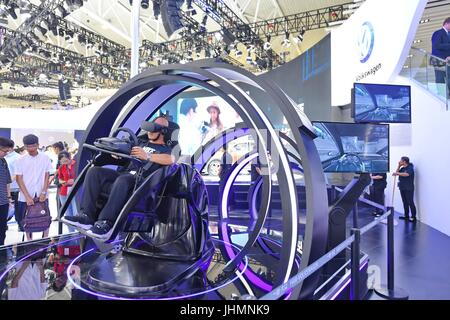 Changchun, China's Jilin Province. 15th July, 2017. A visitor experiences car driving via VR technology during the - Stock Photo