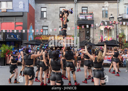 Montreal, Canada - 13 July 2017: 'Minutiens' Street performers with VR headsets during Montreal Circus Arts Festival - Stock Photo