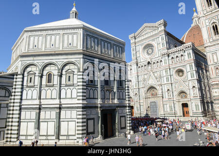Firenze, Italy - 5 July 2017: people walking on Duomo square in front of the cathedral at Florence, Italy. - Stock Photo