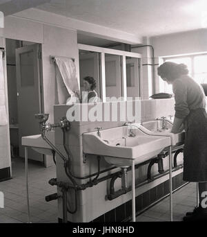 1950s, historical, female students using the washroom at a teachers training college, England, UK. - Stock Photo