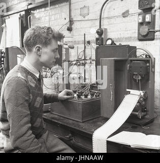 1950s, historical, male student in a laboratory workshop doing chemical analysis with a polarograph instrument, Oxford Unversity, Oxford, England, UK.