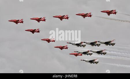 The Red Arrows flying in formation with the USAF Thunderbirds at the Royal International Air Tattoo 2017 - Stock Photo