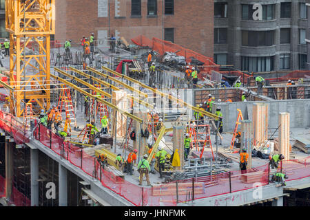 a busy construciton site on a high-rise building on the upper west side of manhattan - Stock Photo
