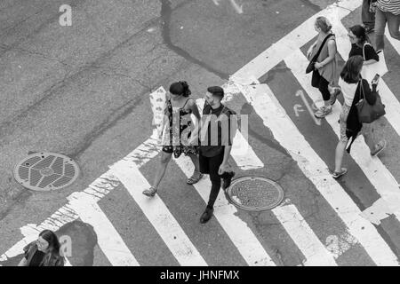 people crossing West 61st street in manhattan - Stock Photo