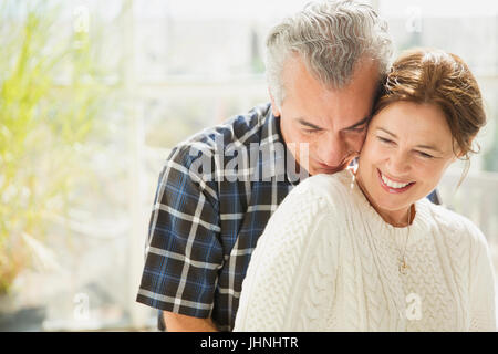 Affectionate mature couple smiling - Stock Photo