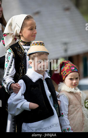 Childs in traditional costume at 'Udatoriul' old agrarian custom on Easter Monday, Surdesti, District of Maramures, - Stock Photo