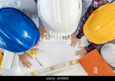 Group of young engineers or architects working in the office. engineers or architects meeting and planning project. - Stock Photo