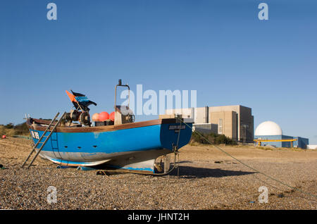 Boat resting on the shingle beach at Sizewell with the nuclear power station in the background. Sizewell beach near - Stock Photo