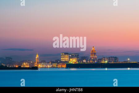 Batumi, Adjara, Georgia. Colorful Bright Evening Sky Over Resort Town At Sunset Or Sunrise. View From Sea Beach - Stock Photo