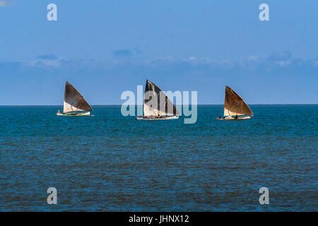Three fishing boats in Amborovy (Mahajanga), western Madagascar. - Stock Photo