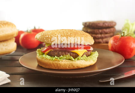 Cheeseburger and its ingredients - Stock Photo