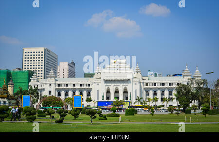 Yangon, Myanmar - Feb 13, 2017. The City Hall Building with Mahabandoola park in Yangon, Myanmar. Yangon is a former - Stock Photo