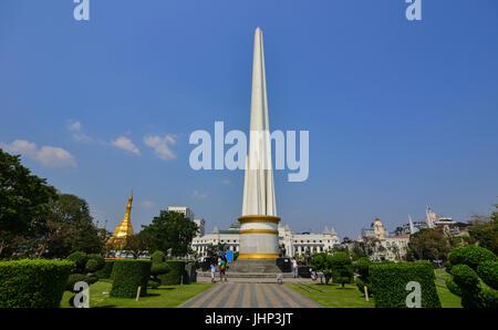 Yangon, Myanmar - Feb 13, 2017. Independence Monument at sunny day in Yangon, Myanmar. Yangon property market is - Stock Photo