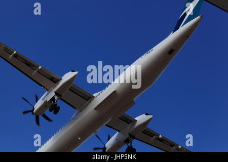 Dehavilland Canada DHC-8-402 C-GWEO WestJet on final approach at Ottawa International airport YOW, December 05,2015 - Stock Photo