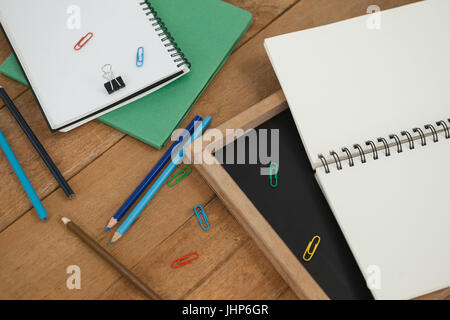 Close-up of various school supplies on wooden table - Stock Photo