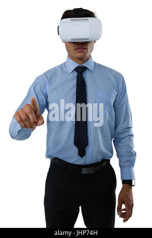 Businessman using invisible interface while wearing vr glasses against white background - Stock Photo