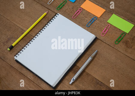 Various school supplies arranged on wooden table - Stock Photo