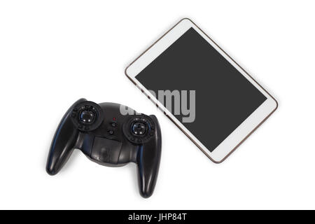 Close-up of joystick and digital tablet on white background - Stock Photo