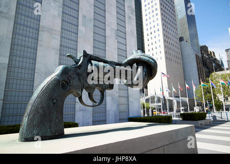 tied gun barrel non-violence sculpture in the grounds of the united nations New York City USA - Stock Photo