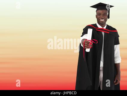 Digital composite of Graduate man smiling against blurry red and peach background - Stock Photo