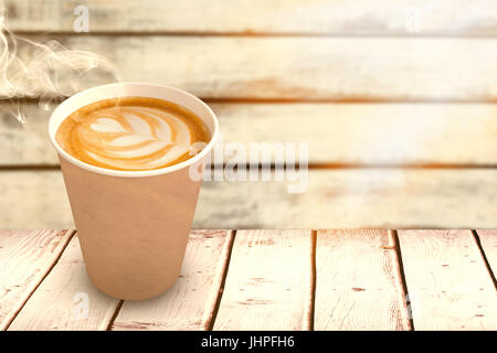 Coffee cup over white background against wood background - Stock Photo