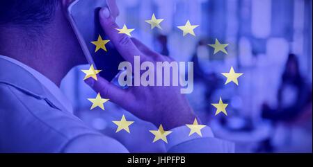 European flag against businessman talking on mobile phone - Stock Photo