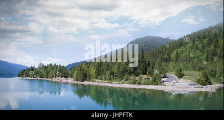 Close-up of connection dots against trees reflecting in calm lake against sky - Stock Photo