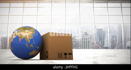 3D image of planet Earth and box against modern room overlooking city - Stock Photo