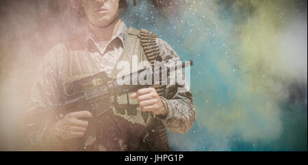 black against military carrying a rifle - Stock Photo