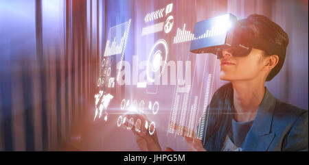 Young woman wearing black virtual reality simulator glasses against tables in office cafeteria - Stock Photo