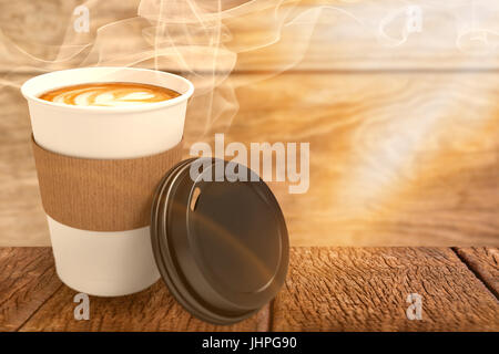Coffee on white cup in front of its cover against brown wood panelling - Stock Photo