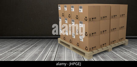 Cardboard boxes arranged on wooden pallet against dark room - Stock Photo