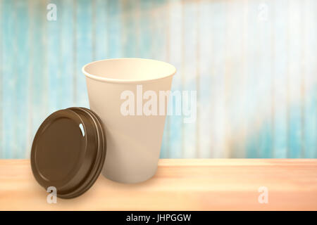 White cup in front of its cover against view of wooden planks - Stock Photo