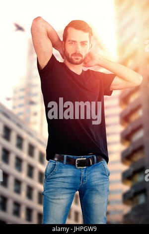 Portrait of model against white background against modern buildings - Stock Photo