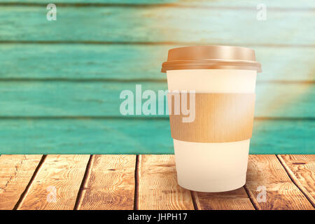 White cup over white background against full frame shot of turquoise wall - Stock Photo