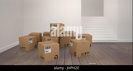 Group of composite cardboard boxes against empty room - Stock Photo