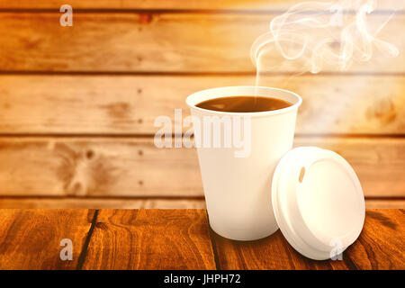 Dark coffee on white cup over white background against wooden planks background - Stock Photo