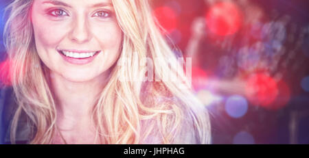 Portrait of beautiful young woman with blond hair at cafe Stock Photo
