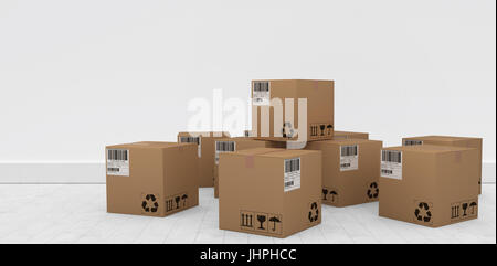 Group of graphic cardboard boxes against gray flooring and wall - Stock Photo