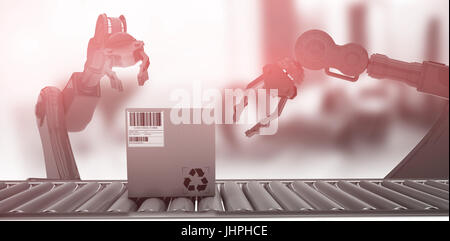 Packed carton box on production line against empty work station - Stock Photo