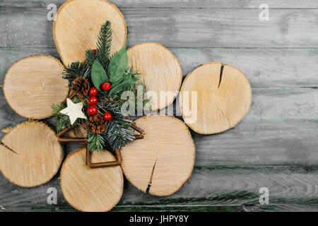 Christmas poinsettia flower background border with holly, ivy, mistletoe, pine cones and fir leaf sprigs - Stock Photo