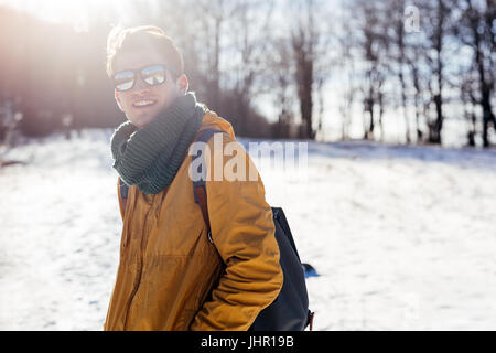 Young guy in the woods exploring nature in winter time, individuality and freedom concept - Stock Photo