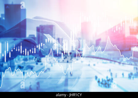 Hand holding computer mouse with digital stock exchange investment financial charts in foreground and business district - Stock Photo