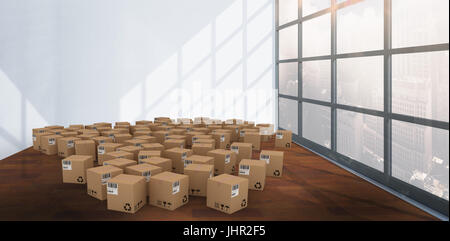 Group of digital composite cardboard boxes against interior of empty room - Stock Photo