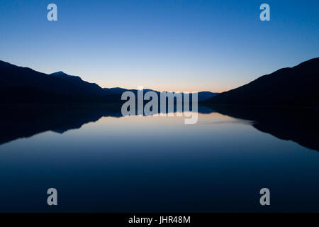 Scenic view of lake against blue sky during sunset - Stock Photo