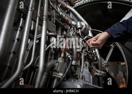 Engineer holding jet engine turbine blade in aircraft maintenance ...