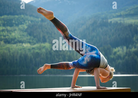 young woman practicing yoga eka pada rajakapotasana king