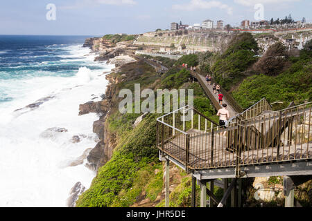 The Bondi to Coogee coastal walk with rough seas and Waerley cemetery in the background, Sydney, New South Wales, - Stock Photo
