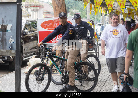 Bangkok policemen on bicycles, Bangkok, Thailand - Stock Photo