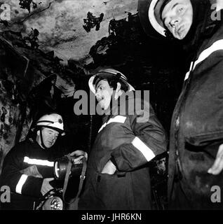 Station officer from West Midlands Fire Brigade (centre) inspects aftermath of flat fire in Wolverhampton - Stock Photo